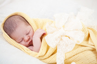 0bigstock-sleeping-newborn-baby-wrapped--35695436