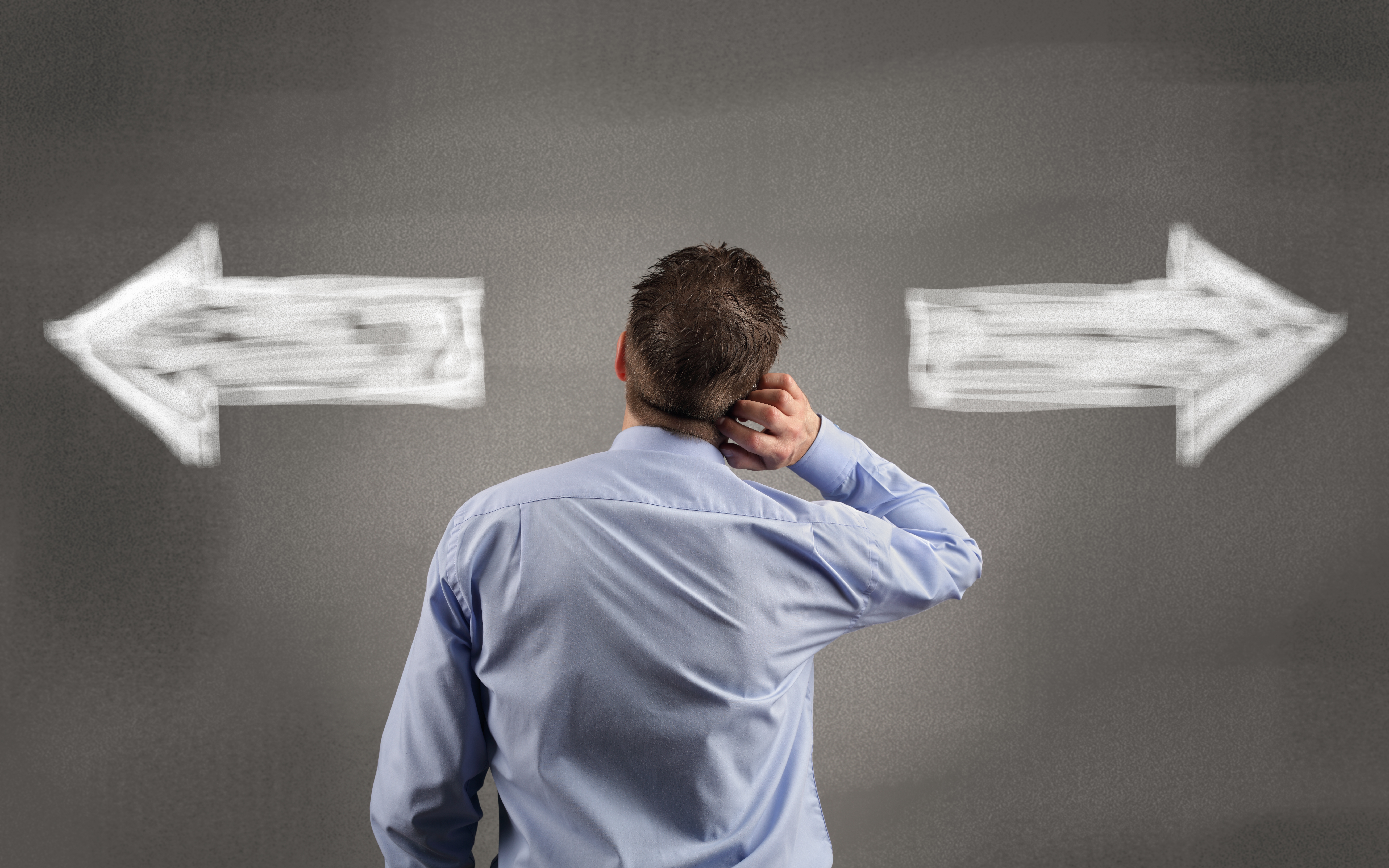 Direction choices and decisions for thoughtful businessman with